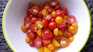 Red yellow cherry tomatoes cut in half