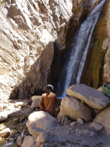 An woman sitting by the Cascade in the Devil's Throat